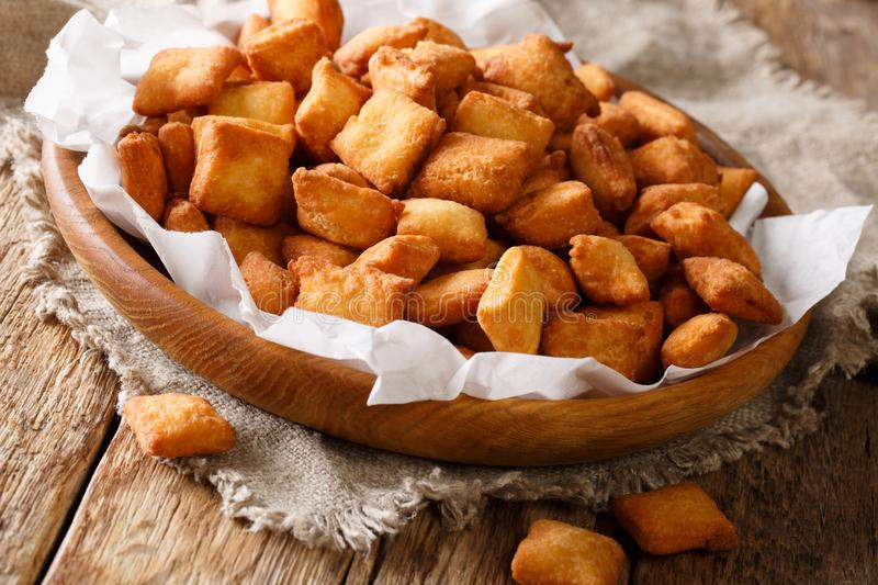 Golden Nigerian snack Chin Chin of deep-fried crispy dough with. A nutmeg close-up in a bowl on the table. horizontal stock photos