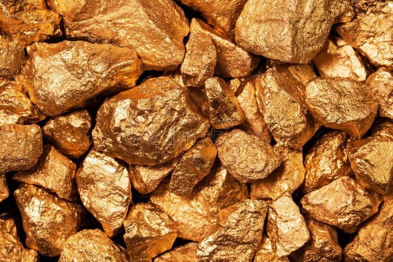 Golden nuggets closeup. stock photos