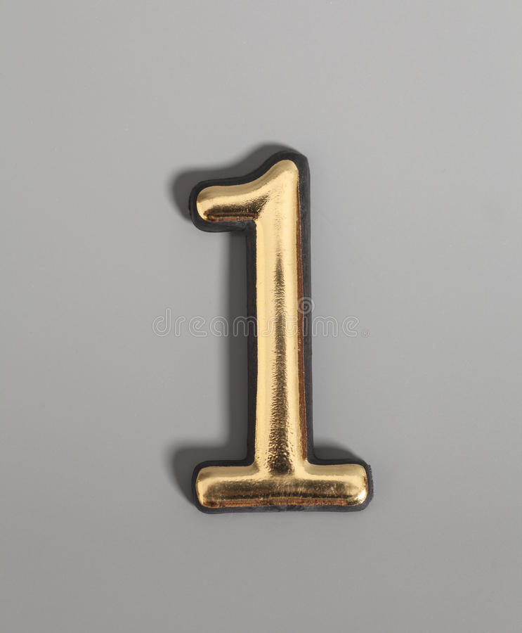 Golden number 1. On gray background royalty free stock images