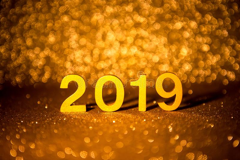 Golden Number 2019 placed on dark elegant glamour night gold glitter tone background for a new year 2019 celebration concept stock photo