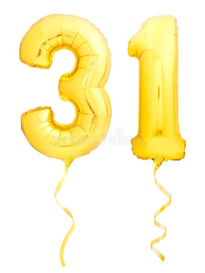 Golden number 31 thirty one made of inflatable balloon with ribbon on white. Golden number 31 thirty one made of inflatable balloon with golden ribbon isolated stock image