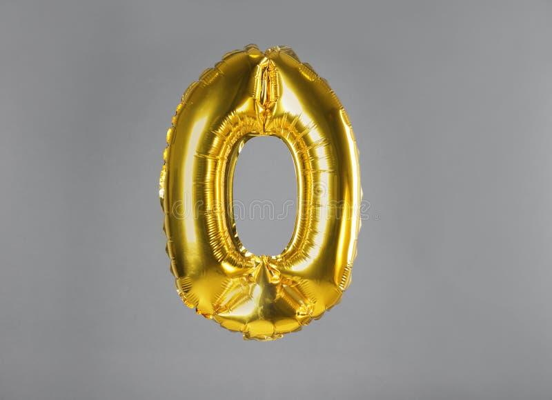 Golden number zero balloon on background. Golden number zero balloon on grey background stock images