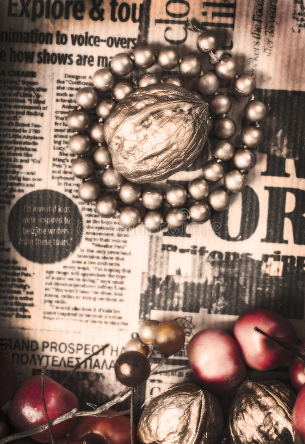 Golden nut on vintage grungy newspaper royalty free stock photos