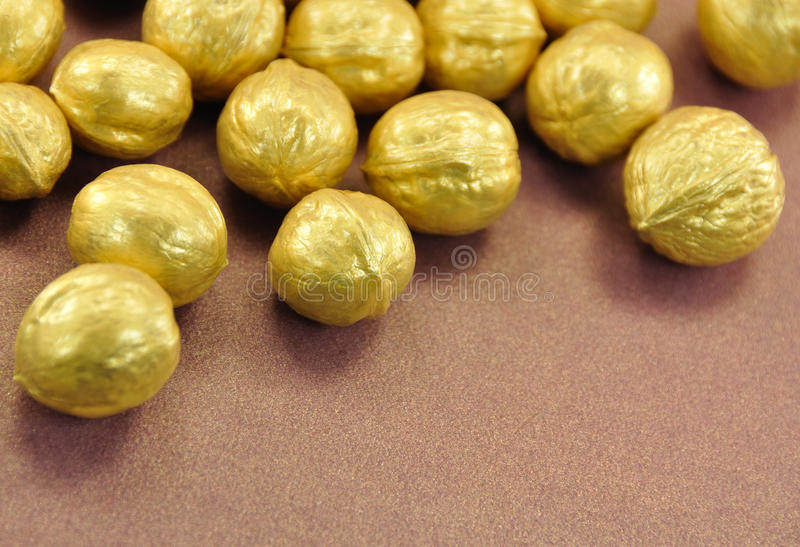 Golden Nuts On Brown Background Royalty Free Stock Photo