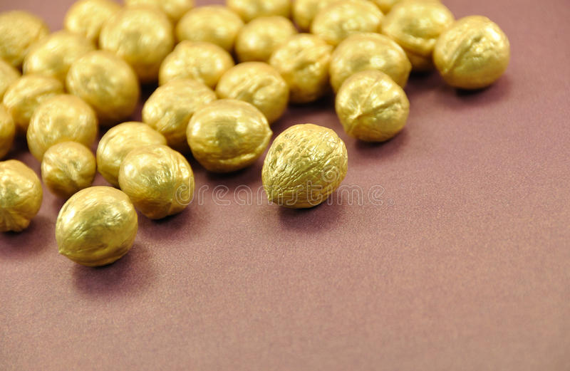 Download Golden Nuts On Brown Background Stock Image - Image: 12915725