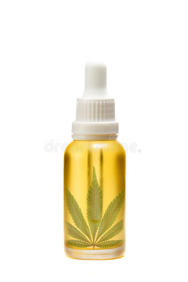 Golden oil in a dropper bottle royalty free stock images