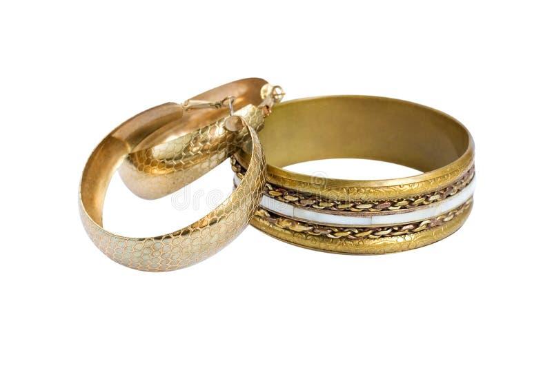 Golden old vintage bracelet and hoop earrings royalty free stock images