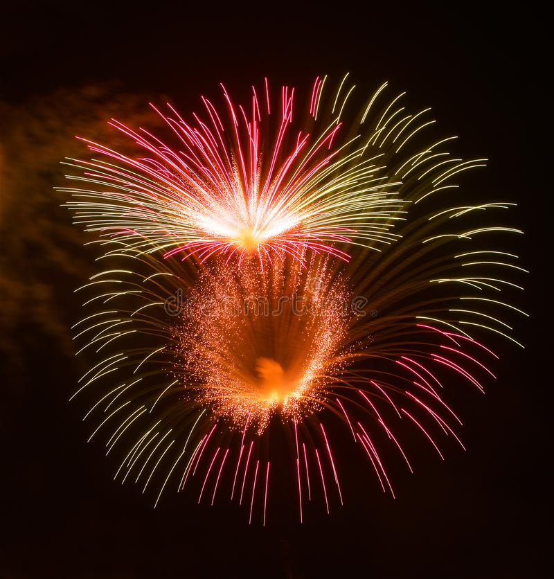 Golden orange amazing fireworks isolated in dark background close up with the place for text, Malta fireworks festival royalty free stock photos
