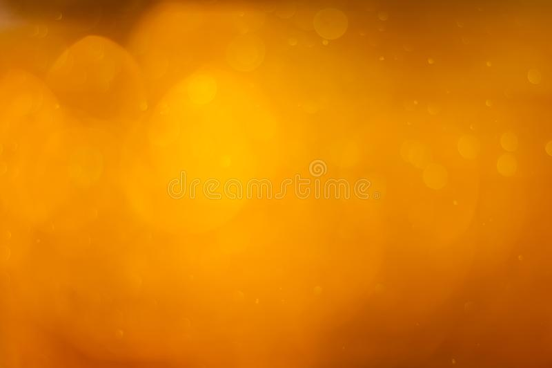 Golden orange bokeh or luxurious glitter lights festive background stock photos