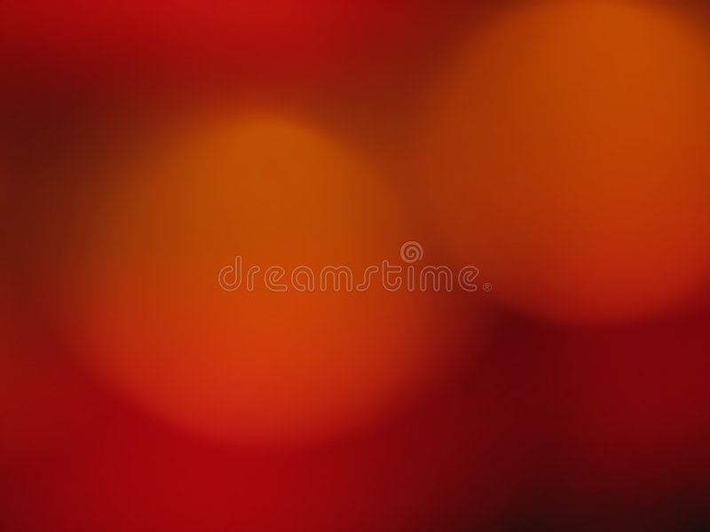 Golden orbs in red background stock photo