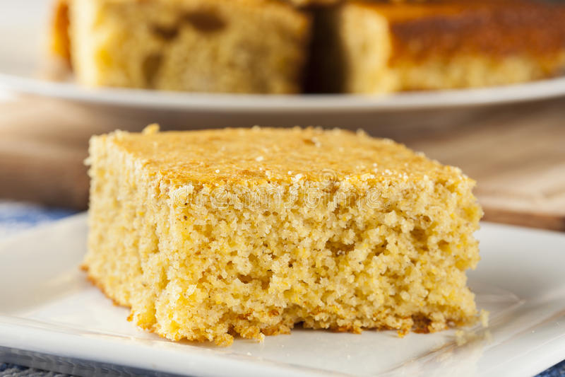 Golden Organic Homemade Cornbread. Cut into squares royalty free stock photos