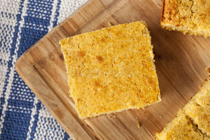 Golden Organic Homemade Cornbread. Cut into squares stock photos