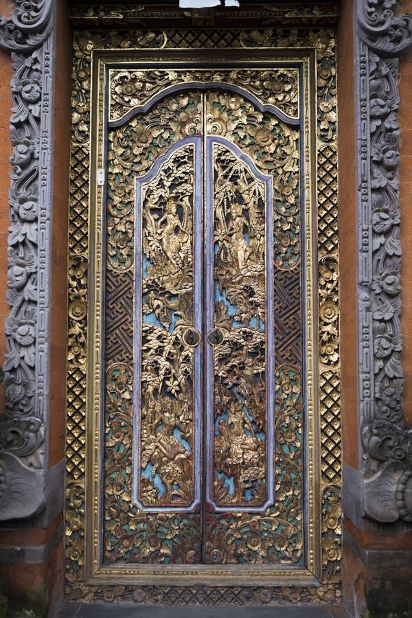 Golden ornamented door. In Bali, Indonesia royalty free stock images