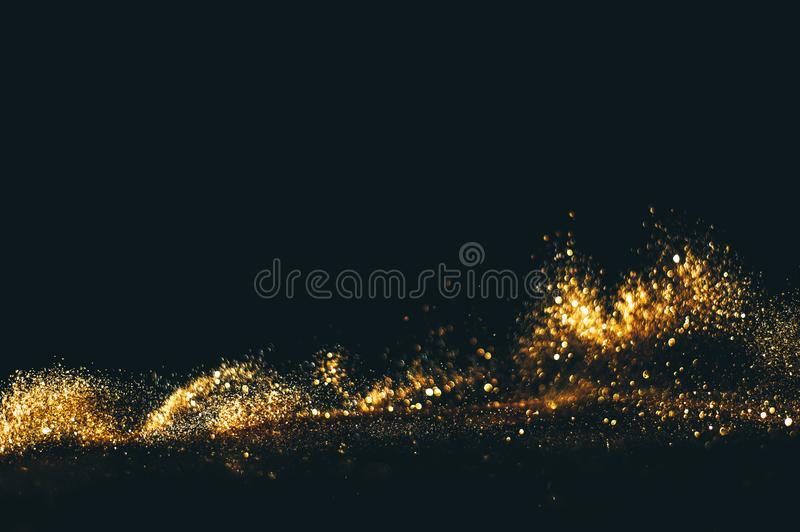 Golden overlay background of golden lights with bokeh effect. Includes copy space.  stock photo