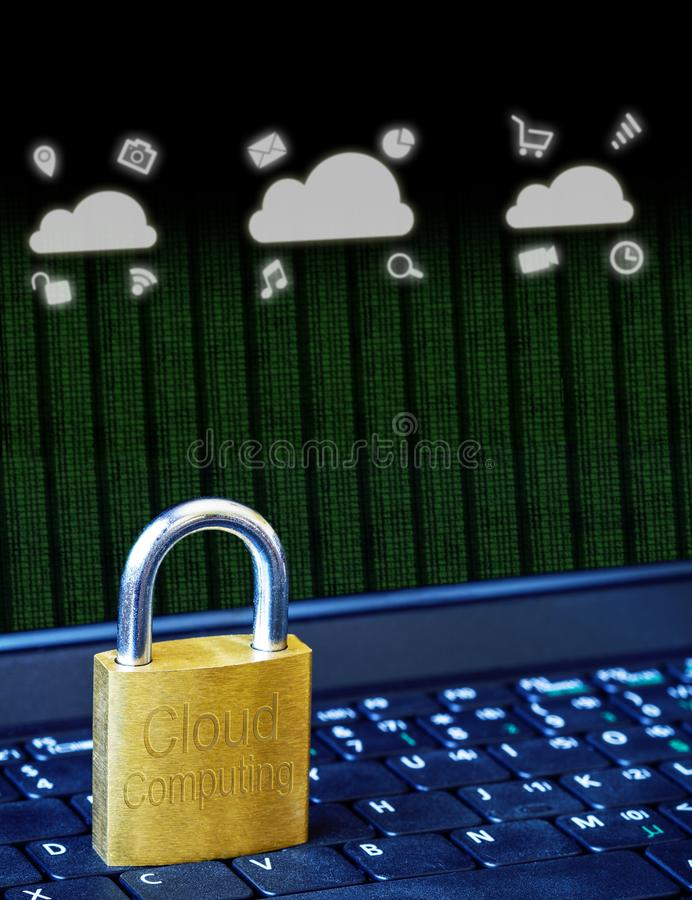 Golden padlock on computer laptop keyboard with Cloud Computing icons and binary data. Concept of Internet security, data privacy stock images