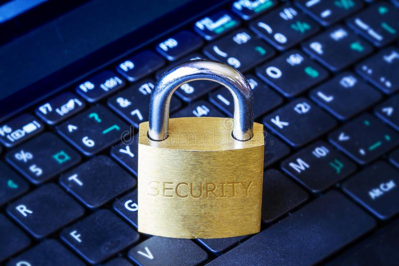 Golden Padlock on Keyboard Cyber Security Concept. Golden padlock on computer laptop keyboard with Security word engraved. Concept of Internet security, data royalty free stock images