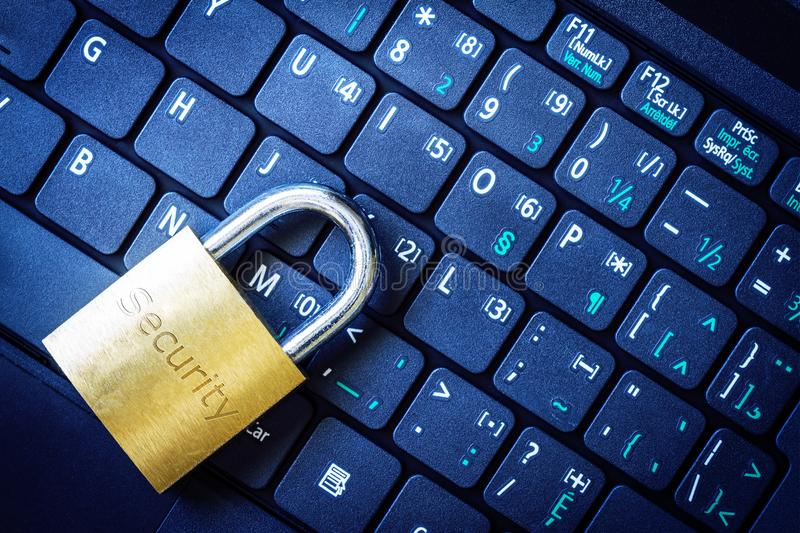 Golden Padlock on Keyboard Cyber Security Concept. Golden padlock on computer laptop keyboard with Security word engraved. Concept of Internet security, data stock images