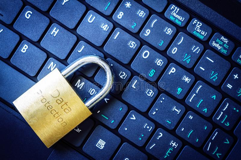 Golden Padlock on Keyboard Cyber Security Concept. Golden padlock on computer laptop keyboard with Security word engraved. Concept of Internet security, data stock photos