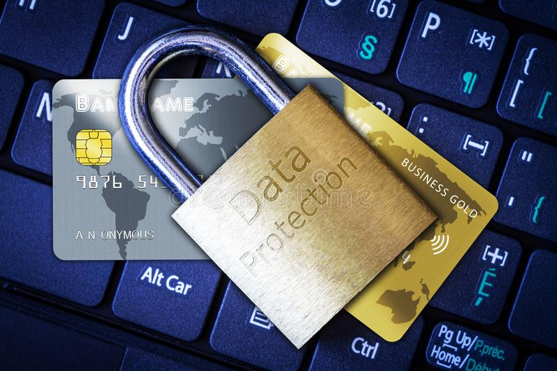 Padlock on Top of Credit Cards on Keyboard Cyber Security Concept. Golden padlock on top of credit or debit cards on computer keyboard. Concept of Internet royalty free stock image