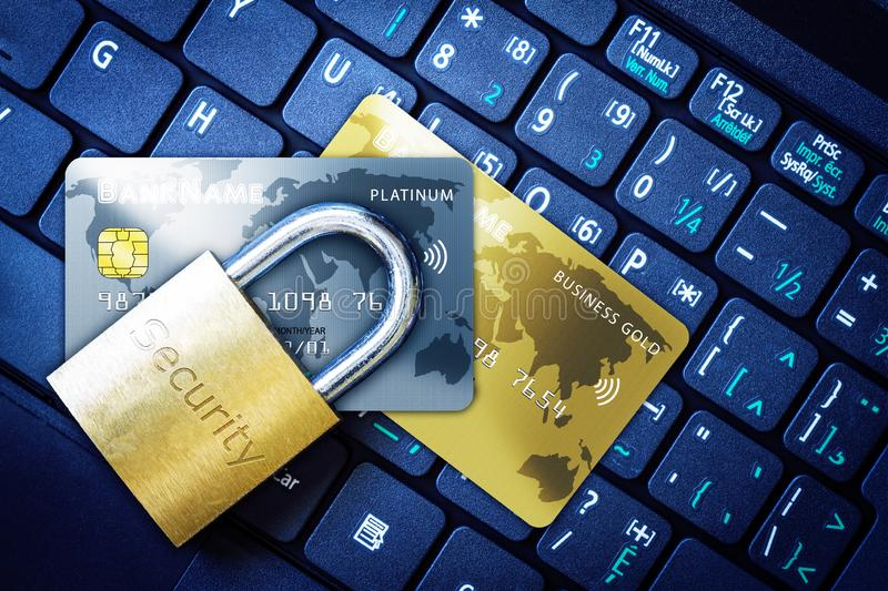 Padlock on Top of Credit Cards on Keyboard Cyber Security Concept. Golden padlock on top of fictitious credit cards on computer keyboard. Concept of Internet royalty free stock photo
