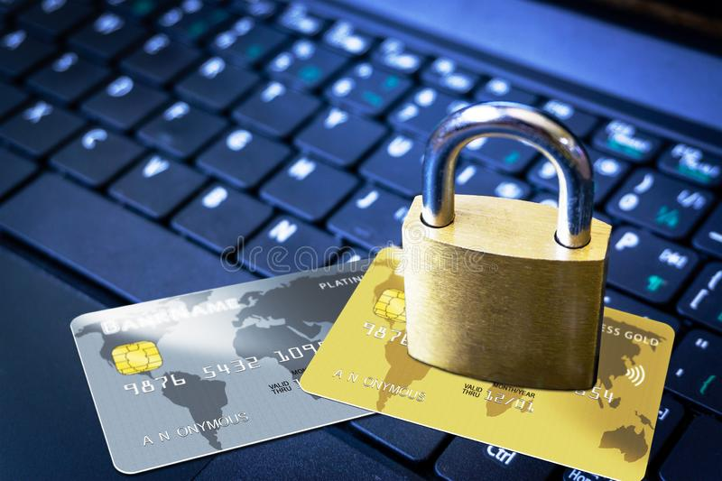 Padlock on Top of Credit Cards on Keyboard Cyber Security Concept. Golden padlock on top of fictitious credit cards on computer keyboard. Concept of Internet stock images