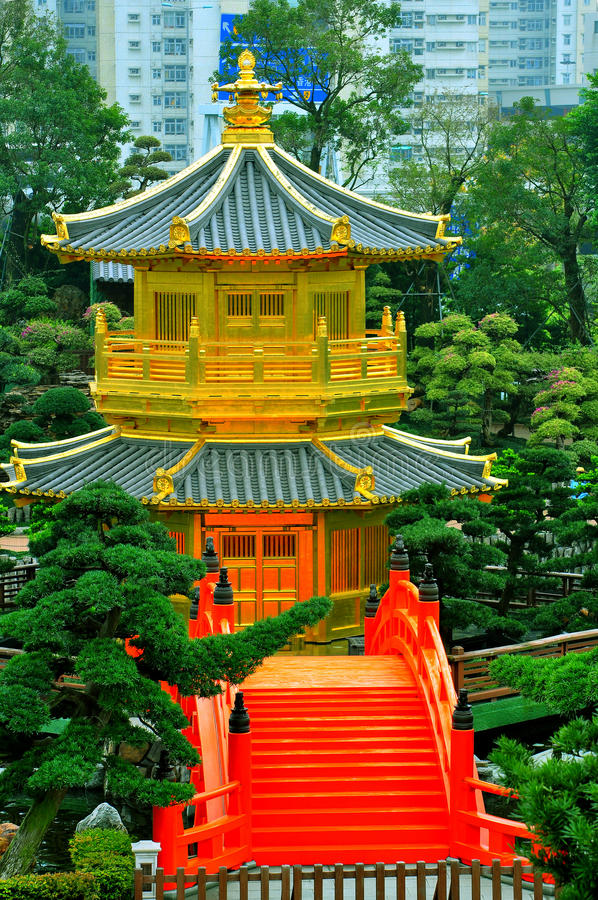 Golden pagoda in chinese garden stock images
