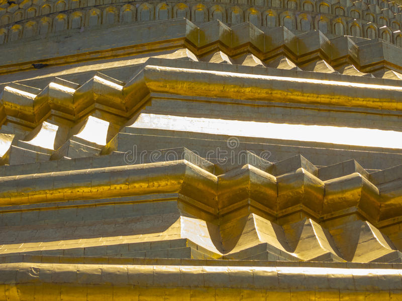 Golden pagoda detail in Myanmar. Golden detail on the pagoda made of gold stock images