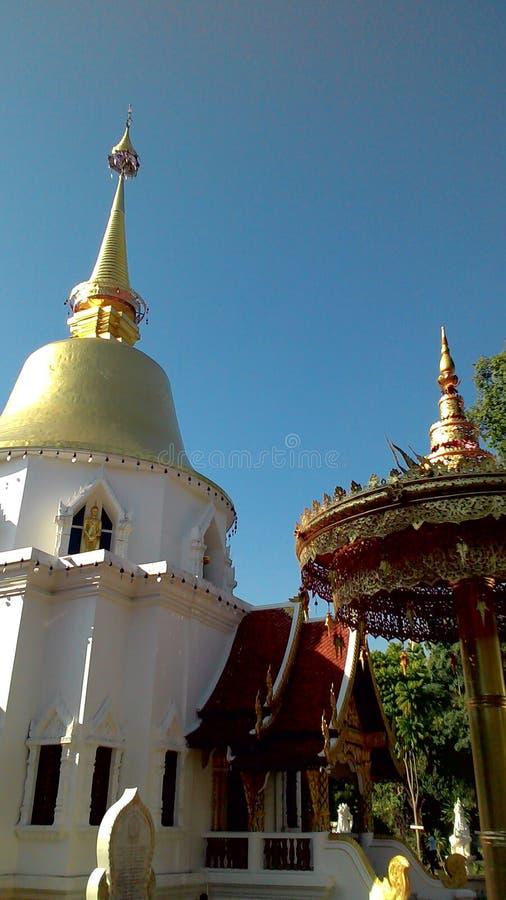 Golden Pagoda and Metal Umbrella stock photography