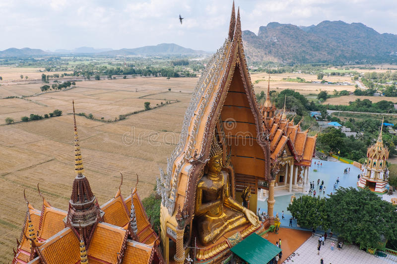 Golden pagoda statue with mountain, Wat Tham Sua(Tiger Cave Temple) stock photography