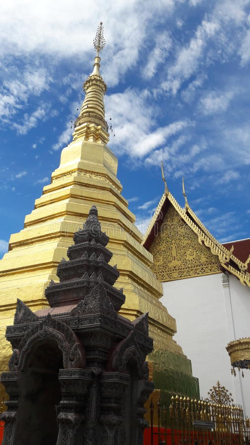 Golden pagoda in temple of Thailand stock image