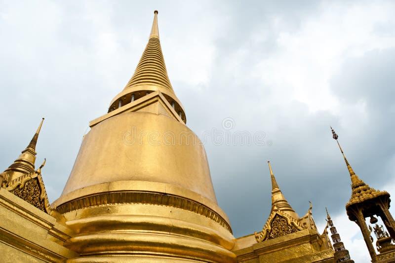 Golden pagoda at Temple Wat Prakaew royalty free stock photos