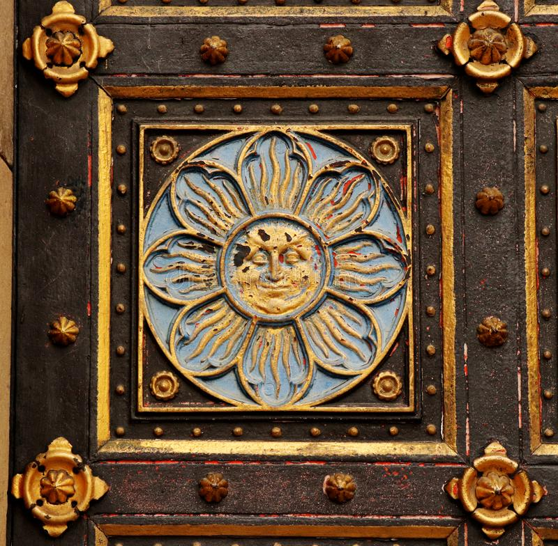 A golden paiting on entrance to vysehrad castle in prague city. Flower with golden sun face stock photos