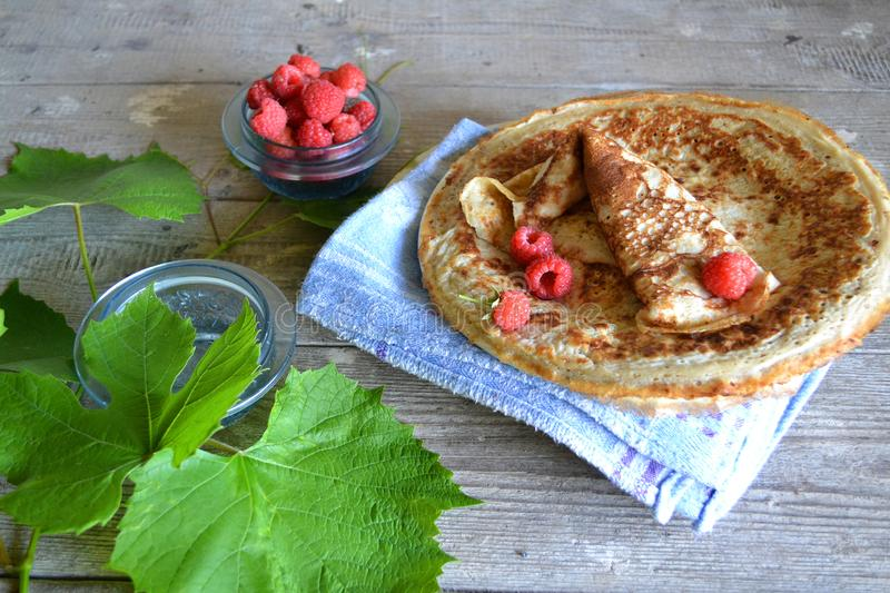 Golden pancakes on white background. Breakfast food table. Pancake stack with fresh raspberries stock photography