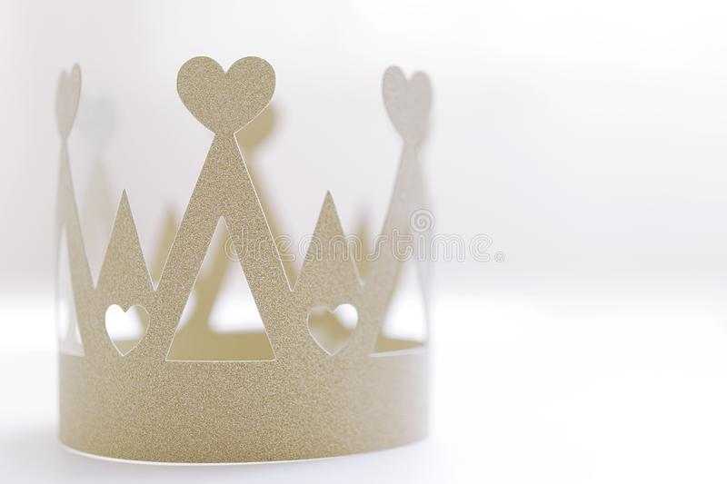 Golden paper crown on white background stock photography