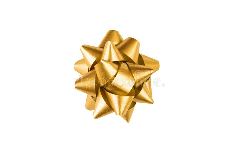 Golden paper holiday bow over white isolated background. Single object. Mockup. Top view. Decoration for present royalty free stock photography