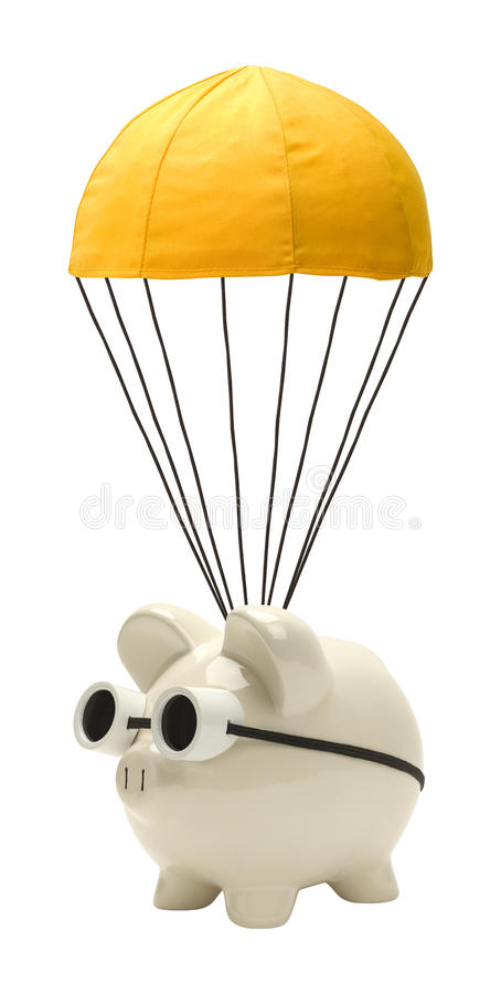 Golden Parachute. Piggy Bank with Golden Parachute Isolated on White stock image