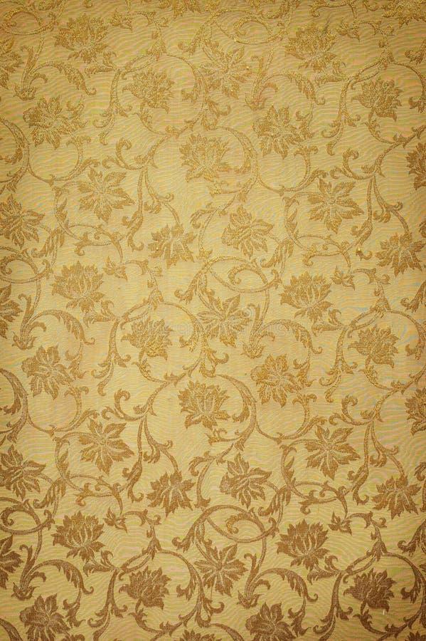 Golden pattern on wallpaper stock photo