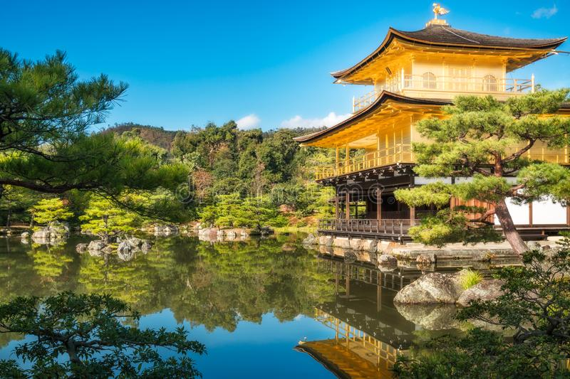 The Golden Pavilion and the beautiful surrounding Japanese Zen Garden, Kyoto, Japan. The Golden Pavilion or Kinkaku-ji Temple and the beautiful surrounding stock photo