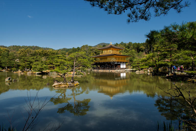The Golden Pavilion Temple. Kyoto, Japan - April 8, 2013: Kinkaku-ji or the Golden Pavilion Temple in Kyoto on a sunny spring day. The Golden Pavilion is one of stock photography