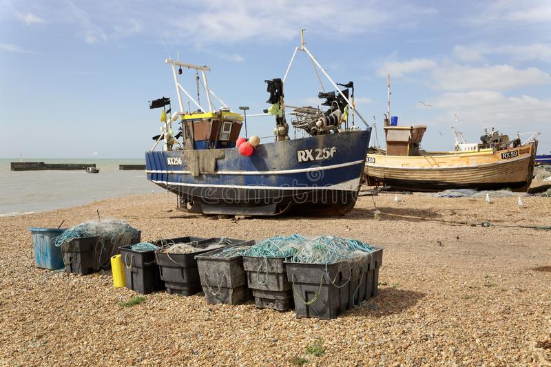 Hastings, Sussex, England. Several fishing boats and nets on the beach stock photo