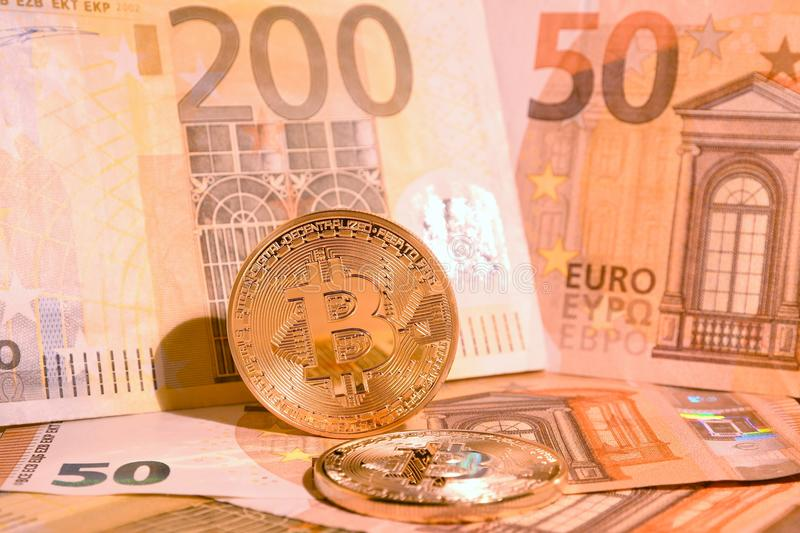 Golden Phisical Bitcoin With Euro Banknotes. Bitcoin Cryptocurrency. Stock Photo - Image of ...