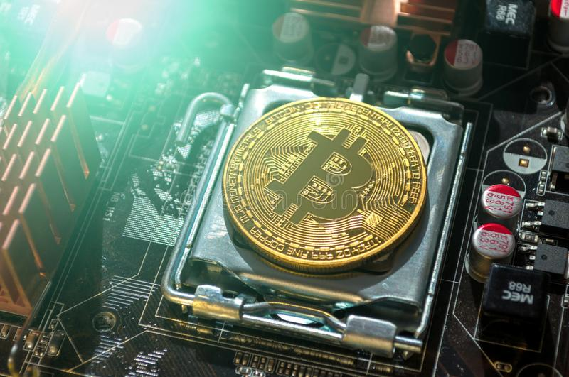 Golden physycal bitcoin. Business concept of digital cryptocurrency. Blockchain technology and bitcoin mining royalty free stock images