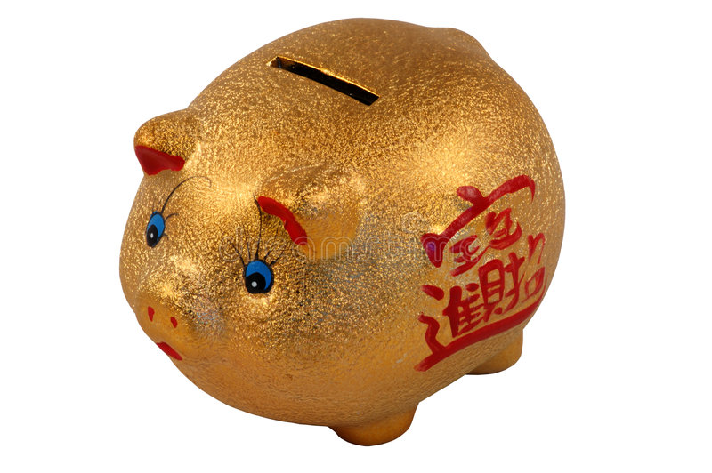Golden piggy bank. Isolated with clippingpath included royalty free stock photography