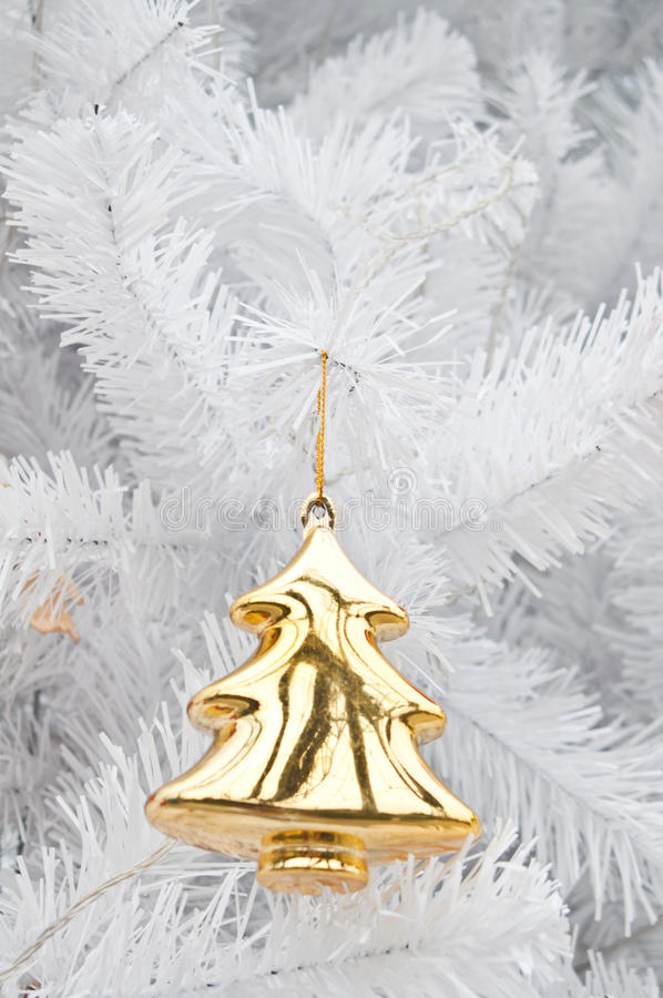 Golden pine statue on white christmas tree royalty free stock photos