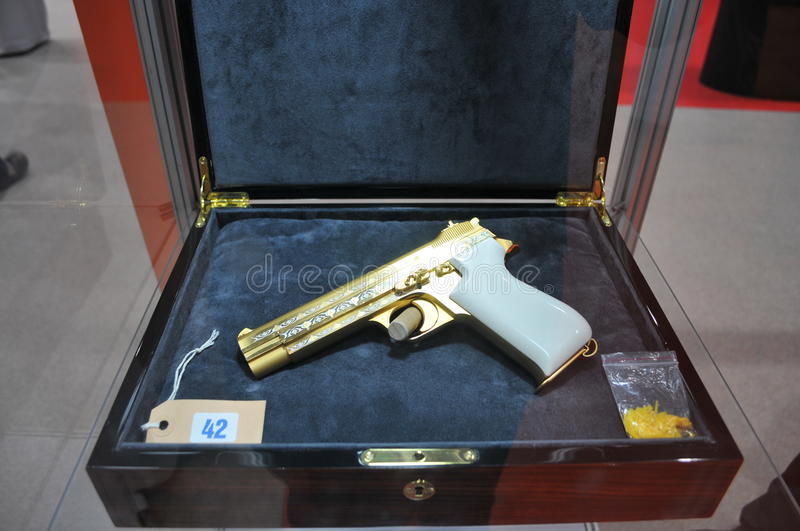 Download Golden Pistol Display In Abu Dhabi International Hunting And Equestrian Exhibition 2013 Editorial Photo - Image: 33502911