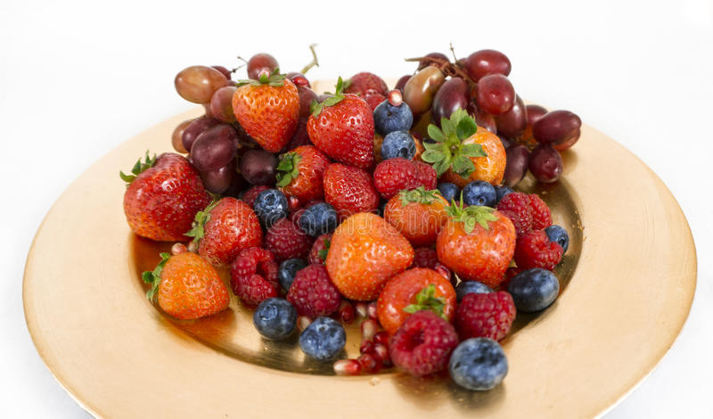 Golden plate with seasonal fruit royalty free stock photo