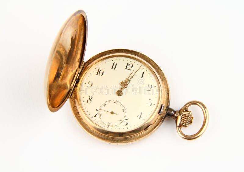 Golden pocket watch stock images