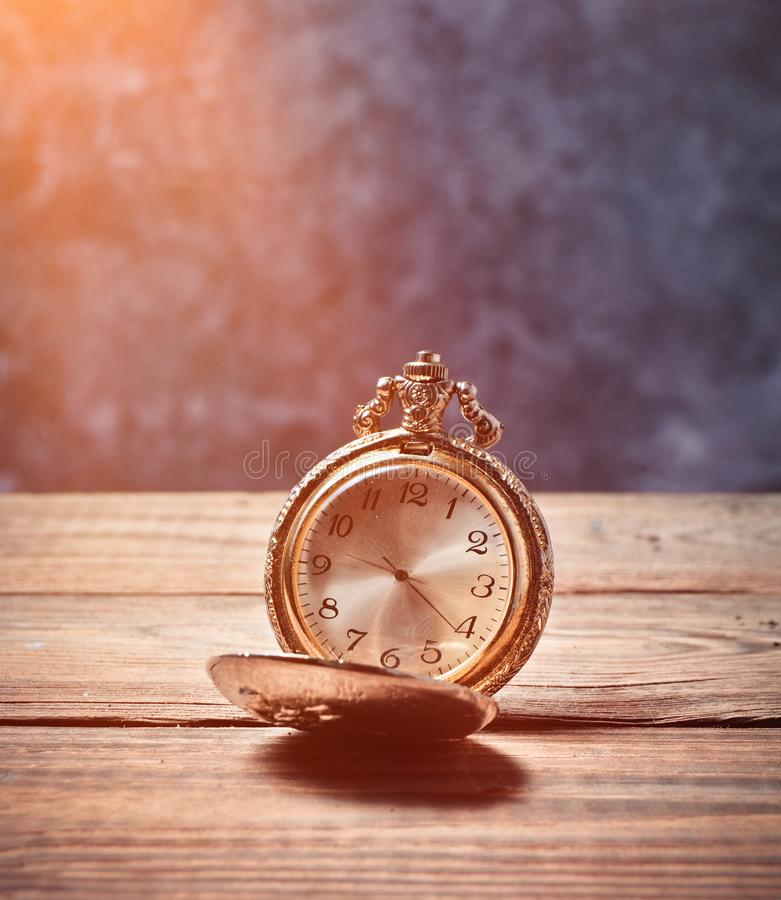 Golden pocket watch retro style close-up royalty free stock images
