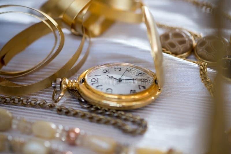 Golden pocket watch for sale stock images