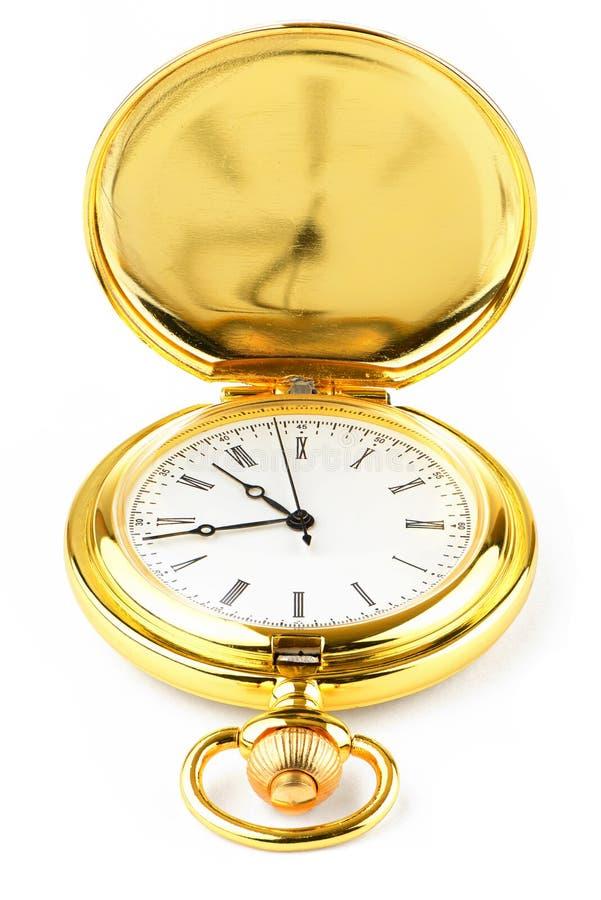 Golden pocket watch on white background royalty free stock photo